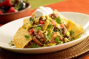 Green Chilaquiles with Carnitas and Eggs